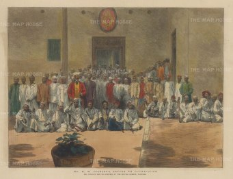 Portrait of Henry Morton Stanley and his porters outside of the British Agency in Zanzibar.
