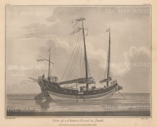 A traditional Chinese vessel with its sails down.