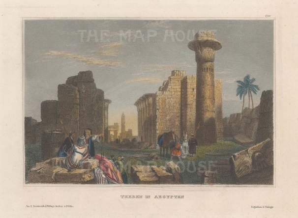View of ruins with the column of Tarhaqa.
