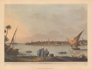 View of the city and it's port of feluccas from across the Nile.