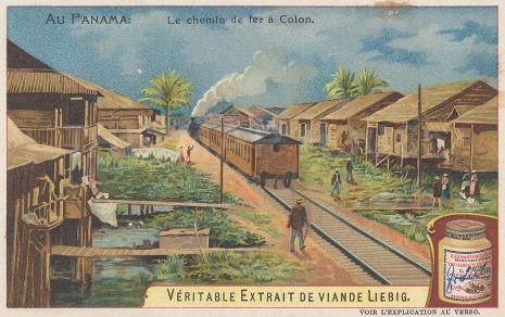 A steam train going through the town.