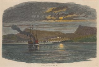 View of the city from the sea with a steam ship with sails in the foreground.